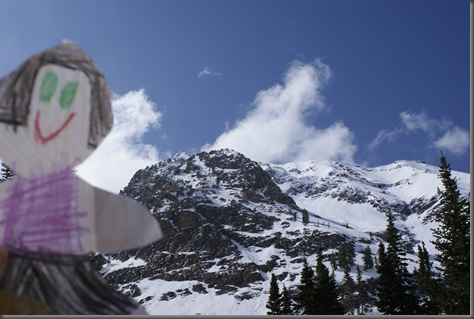 Flat Sheri with the snowy moutains behind her